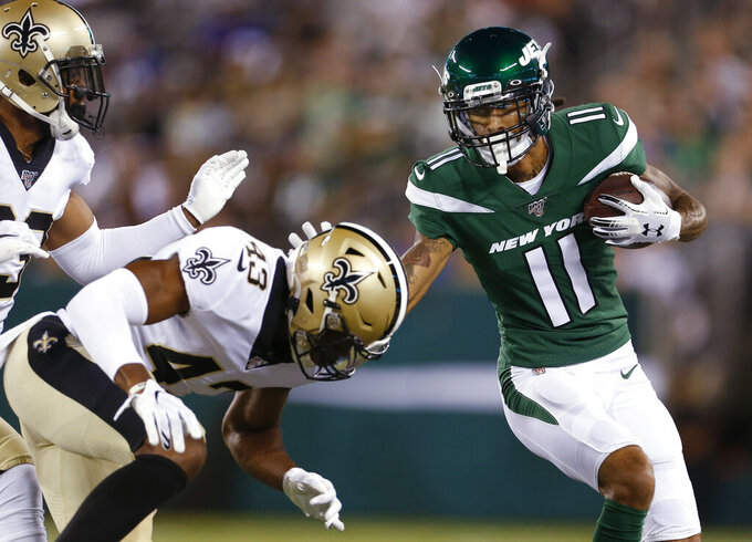 New York Jets' Robby Anderson (11) stiff-arms New Orleans Saints' Marcus Williams (43) during the first half of a preseason NFL football game Saturday, Aug. 24, 2019, in East Rutherford, N.J. (AP Photo/Adam Hunger)