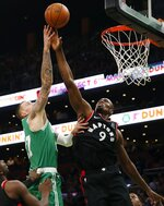 Toronto Raptors' Serge Ibaka (9) blocks a shot by Boston Celtics' Daniel Theis (27) during the first half of an NBA basketball game in Boston, Friday, Oct. 25, 2019. (AP Photo/Michael Dwyer)