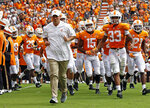 FILE - In this Sept. 15, 2018, file photo, Tennessee head coach Jeremy Pruitt leads his team as they run through the Power T before an NCAA college football game against UTEP in Knoxville, Tenn. The SEC West often brings out the worst in Tennessee. The Volunteers have lost 15 straight interdivisional games and haven't beaten an SEC West team since 2010. (AP Photo/Wade Payne, File)