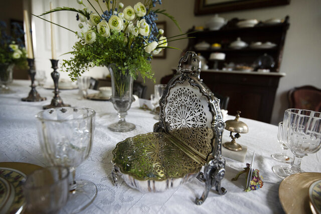 Angie Yeomans, through her son, Bob, and daughter-in-law, Gay, donated 120 items including this silver bread warmer, Tuesday, June 23, 2020 in Janesville, Wis..(Angela Major/The Janesville Gazette via AP)