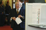 Ireland's President Michael D Higgins prepares to cast his vote for the Irish General Election, in Dublin, Ireland, Saturday Feb. 8, 2020. Voting is under way in Ireland for what is widely predicted to be an unpredictable outcome.(Brian Lawless/PA via AP)
