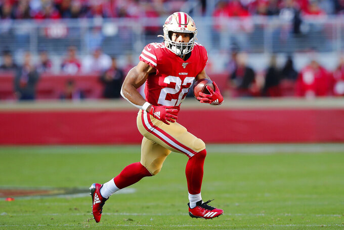 San Francisco 49ers running back Matt Breida (22) runs against the Atlanta Falcons during the first half of an NFL football game in Santa Clara, Calif., Sunday, Dec. 15, 2019. (AP Photo/John Hefti)