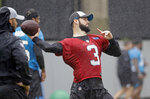 Carolina Panthers rookie quarterback Will Grier (3) throws a pass during the NFL football team's rookie camp in Charlotte, N.C., Friday, May 10, 2019. (AP Photo/Chuck Burton)