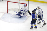 St. Louis Blues' Oskar Sundqvist (70), of Sweden, celebrates after scoring past Tampa Bay Lightning goaltender Andrei Vasilevskiy, of Russia, and Mikhail Sergachev (98) during the third period of an NHL hockey game Tuesday, Nov. 19, 2019, in St. Louis. The Blues won 3-1. (AP Photo/Jeff Roberson)