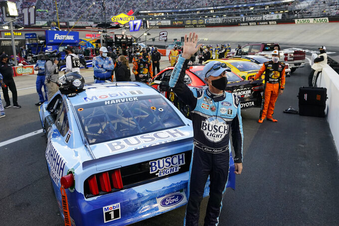Kevin Harvick waves to the crowd during driver introductions prior to the start of a NASCAR Cup Series auto race Saturday, Sept. 19, 2020, in Bristol, Tenn. (AP Photo/Steve Helber)