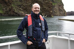 Andy Bool, head of Sea Life Trust in Klettsvik Bay, Heimaey Island, Iceland, Tuesday June 18, 2019 where two Beluga Whales Little White and Little Grey are being rehomed in an open-water sanctuary after years of captivity in Shanghai, China. In a world first by the Sea Life Trust, the whales have been transported 6,000 miles by air, land and sea to Iceland where they will be cared for in a special tank for around a month before being permanently moved to their new, open-water home.  (Aaron Chown/PA via AP)