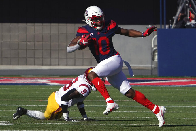 FILE - Arizona wide receiver Jamarye Joiner (10) runs n the second half during an NCAA college football game against Southern California in Tucson, Ariz., in this Saturday, Nov. 14, 2020, file photo. (AP Photo/Rick Scuteri, File)
