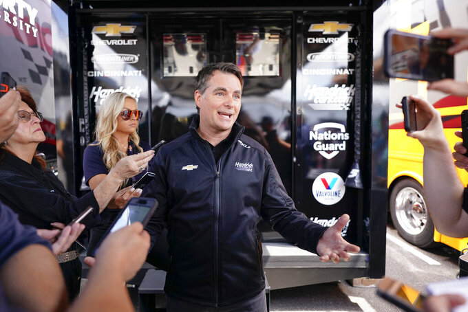 Former Nascar driver Jeff Gordon speaks at a news conference outside a Hendrick Motorsports trailer before the scheduled races at Pocono Raceway, Sunday, June 27, 2021, in Long Pond, Pa. It was announced Wednesday that Gordon was leaving the Fox Sports broadcast booth to become vice chairman at Hendrick Motorsport. (AP Photo/Matt Slocum)