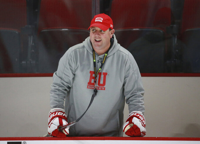 Boston University men's NCAA college hockey coach Albie O'Connell watches practice at Agganis Arena in Boston in this Oct. 9, 2018, photo. Albie O'Connell got the call shortly before his Boston University men's hockey team was supposed to get on the bus and hit the road for its season opener at UConn. On Friday night, Jan. 8, 2021, more than a month later, BU will become the last Division I men's team to start its season when Providence visits. The game will be at Walter Brown Arena because the team's regular home, Agganis Arena, has been repurposed as a campus COVID-19 test site. (Matthew J. Lee/The Boston Globe via AP)