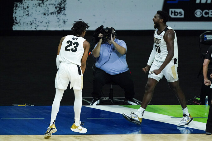 Purdue's Trevion Williams (50) reacts with Jaden Ivey (23) after a dunk during the second half of a first-round game against North Texas in the NCAA men's college basketball tournament at Lucas Oil Stadium, Friday, March 19, 2021, in Indianapolis. Williams was fouled on the play. (AP Photo/Darron Cummings)