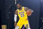 Los Angeles Lakers forward LeBron James poses for photos during the NBA basketball team's media day in El Segundo, Calif., Friday, Sept. 27, 2019. (AP Photo/Ringo H.W. Chiu)