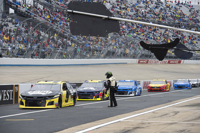 Drivers enter pit road after a NASCAR Cup Series auto race was postponed due to inclement weather conditions Sunday, May 5, 2019, at Dover International Speedway in Dover, Del. (AP Photo/Jason Minto)