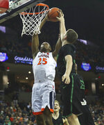 Virginia's forward Mamadi Diakite (25) grabs a rebound over two Marshall defenders during the second half of an NCAA college basketball game on Monday, Dec. 31, 2018, in Charlottesville, Va. Virginia beat Marshall 100-64. (AP Photo/Zack Wajsgras)