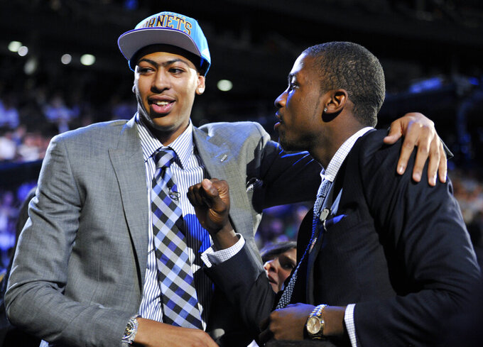 FILE - In this June 28, 2012, file photo, Kentucky's Anthony Davis, left, is congratulated by former teammate Michael Kidd-Gilchrist, right, after Davis was selected as the No. 1 overall draft pick by the New Orleans Hornets at the NBA basketball draft in Newark, N.J. With no Final Four on tap this weekend thanks to the coronavirus, we instead put together a list of the greatest one-and-done players ever. Davis and Syracuse's Carmelo Anthony top our list after leading their teams to national titles their lone season in college. (AP Photo/Bill Kostroun, File)