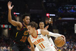 Atlanta Hawks' Trae Young (11) drives past Cleveland Cavaliers' Darius Garland (10) in the second half of an NBA basketball game, Wednesday, Feb. 12, 2020, in Cleveland. The Cavaliers won 127-105. (AP Photo/Tony Dejak)