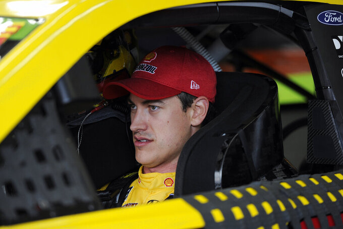 Joey Logano is seen in his car during practice for Sunday's NASCAR Cup Series auto race at Charlotte Motor Speedway in Concord, N.C., Saturday, Sept. 28, 2019. (AP Photo/Mike McCarn)
