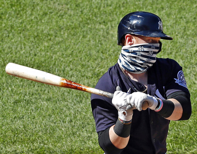 New York Yankees' Clint Frazier wears a face mask while batting during an intrasquad game in baseball summer training camp Sunday, July 12, 2020, at Yankee Stadium in New York. (AP Photo/Kathy Willens)