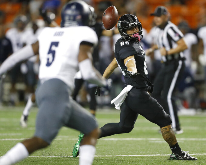 Hawaii wide receiver Jason-Matthew Sharsh (89) fails to catch the ball against Nevada during the second quarter of an NCAA college football game Saturday, Oct. 20, 2018, in Honolulu. (AP Photo/Marco Garcia)