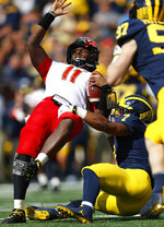 Michigan linebacker Khaleke Hudson (7) brings down Maryland quarterback Kasim Hill (11) in the first half of an NCAA football game in Ann Arbor, Mich., Saturday, Oct. 6, 2018. (AP Photo/Paul Sancya)