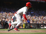 Philadelphia Phillies' Bryce Harper drops his bat after hitting a two-run single off San Francisco Giants' Conner Menez in the second inning of a baseball game Sunday, Aug. 11, 2019, in San Francisco. (AP Photo/Ben Margot)