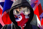 A protester wears a British flag mask during a rally in Hong Kong, Sunday, Jan. 12, 2020. More than a thousand people attended a Sunday rally in Hong Kong to urge people and governments abroad to support the territory's pro-democracy movement and oppose China's ruling Communist Party. (AP Photo/Vincent Yu)