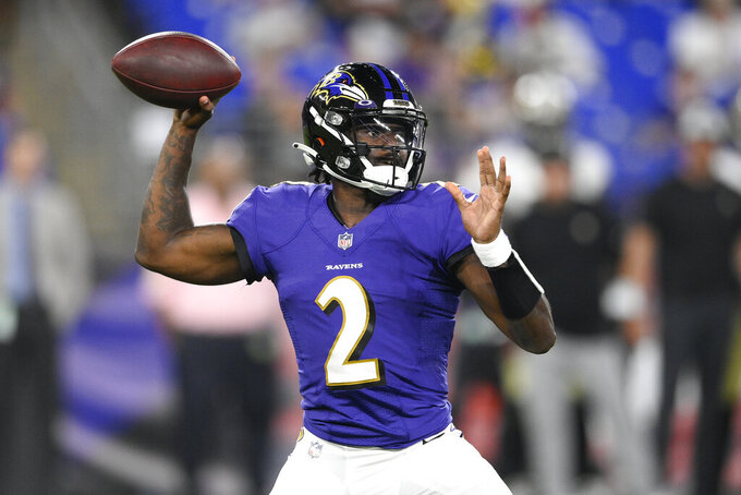 Baltimore Ravens quarterback Tyler Huntley looks to pass against the New Orleans Saints during the second half of an NFL preseason football game, Saturday, Aug. 14, 2021, in Baltimore. (AP Photo/Nick Wass)