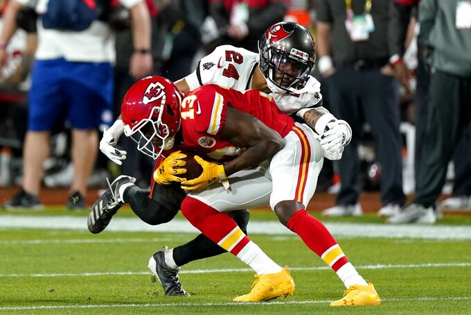 Kansas City Chiefs wide receiver Byron Pringle is tackled by Tampa Bay Buccaneers cornerback Carlton Davis during the first half of the NFL Super Bowl 55 football game Sunday, Feb. 7, 2021, in Tampa, Fla. (AP Photo/Mark Humphrey)