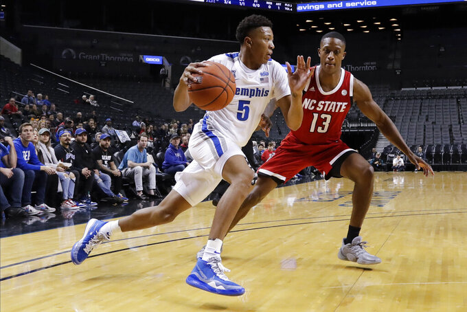 Memphis' Boogie Ellis (5) drives past North Carolina State's C.J. Bryce (13) during the first half of an NCAA college basketball game in the Barclays Classic, Thursday, Nov. 28, 2019, in New York. (AP Photo/Frank Franklin II)