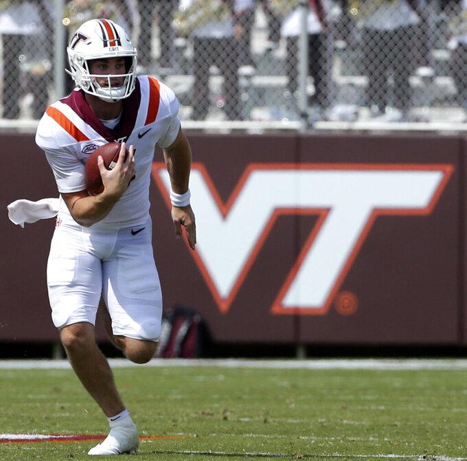 Virginia Tech quarterback Braxton Burmeister (3) runs for a first down in the first half of an NCAA college football game against Middle Tennessee, Saturday, Sept. 11, 2021, in Blacksburg Va. (AP Photo/Matt Gentry)