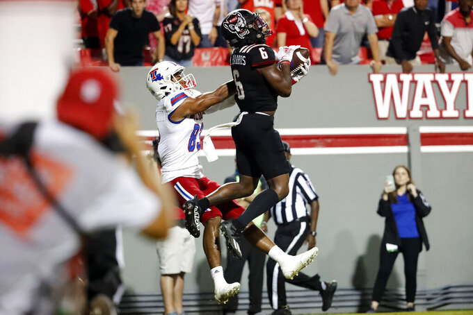 North Carolina State's Jakeen Harris (6) intercepts a pass intended for Louisiana Tech's Tre Harris (83) as time runs out in an NCAA college football game in Raleigh, N.C., Saturday, Oct. 2, 2021. (AP Photo/Karl B DeBlaker)