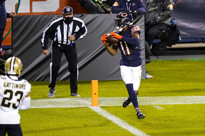 Chicago Bears wide receiver Darnell Mooney (11) runs in for a touchdown after a catch against the New Orleans Saints in the second half of an NFL football game in Chicago, Sunday, Nov. 1, 2020. (AP Photo/Nam Y. Huh)