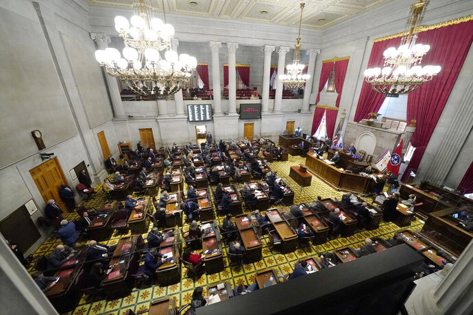 Members of the Tennessee House of Representatives conduct business on the first day of the legislative session Tuesday, Jan. 12, 2021, in Nashville, Tenn. Tennessee lawmakers gathered to start their annual session Tuesday in Nashville amid a pandemic and an FBI probe that drew searches of multiple legislative offices by federal agents last week. (AP Photo/Mark Humphrey)