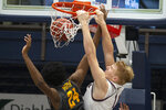 Saint Mary's forward Matthias Tass (11) dunks over Long Beach State center Joshua Morgan (24) during the first half of an NCAA college basketball game Thursday, Nov. 14, 2019, in Moraga, Calif. (AP Photo/D. Ross Cameron)