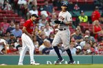 Houston Astros' Carlos Correa, right, scores on a double by Yordan Alvarez during the third inning of a baseball game, Wednesday, June 9, 2021, in Boston. (AP Photo/Michael Dwyer)