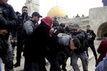 Israeli police arrests a Palestinian in front of the Dome of the Rock mosque in Jerusalem, Monday, Feb. 18, 2019. Israeli police officers have arrested several Palestinians for