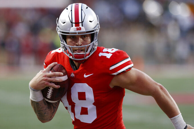 FILE - In this Sept. 22, 2018, file photo, Ohio State quarterback Tate Martell runs against Tulane during an NCAA college football game in Columbus, Ohio. Martell says he is transferring from Ohio State to Miami. Martell originally wanted Miami to notice him in 2016. The Hurricanes got around to it in 2019. Martell took a long, winding road to Coral Gables before transferring from Ohio State earlier this year, and the quarterback insists that he's finally ready to start succeeding. (AP Photo/Jay LaPrete, File)