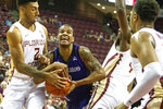 Florida State guard Anthony Polite, left, and North Alabama guard Christian Agnew, right, battle for the ball under the basket in the first half of an NCAA college basketball game in Tallahassee, Fla., Saturday, Dec. 28, 2019. (AP Photo/Mark Wallheiser)