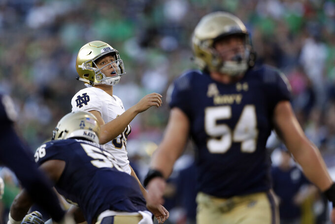 Notre Dame place kicker Jonathan Doerer, back left, reacts after missing an extra point-attempt during the first half of an NCAA college football game against Navy, Saturday, Oct. 27, 2018, in San Diego. (AP Photo/Gregory Bull)