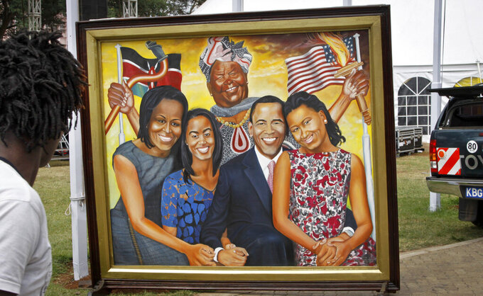 FILE - In this Wednesday, July 22, 2015, file photo, a painting depicting the Obama family and step-grandmother Sarah Obama above, stands outside an exhibition about the Global Entrepreneurship Summit which U.S. President Barack Obama will attend later in the week, in Nairobi, Kenya. Sarah Obama, the matriarch of Barack Obama's Kenyan family has died, relatives and officials confirmed Monday, March 29, 2021 but did not disclose the cause of death. She was at least 99 years old. (AP Photo/Khalil Senosi, File)