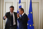 Greece's Prime Minister Kyriakos Mitsotakis, left, welcomes the European Council President Donald Tusk during their meeting at Maximos Mansion in Athens, Wednesday, Oct. 9, 2019. EU leaders have demanded more