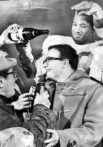 FILE - In this Jan. 1, 1967, file photo, Kansas City Chiefs linebacker Bobby Bell pours champagne over the head of team owner Lamar Hunt after the Chiefs beat the Buffalo Bills to win the AFL championship game in Buffalo, N.Y. For one of the NFL's proudest franchises, the wait to reach this weekend has been a long one, and the chance to hoist the Lamar Hunt Trophy _ named after the Chiefs' founder _ has the city on the edge of its collective seat. (The Kansas City Star via AP, File)