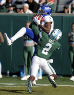 Tulsa wide receiver Keylon Stokes, top, has the ball knocked away by Tulane safety P.J. Hall, bottom, during an NCAA college football game in New Orleans, La., Saturday, Nov. 2, 2019. (A.J. Sisco/The Advocate via AP)