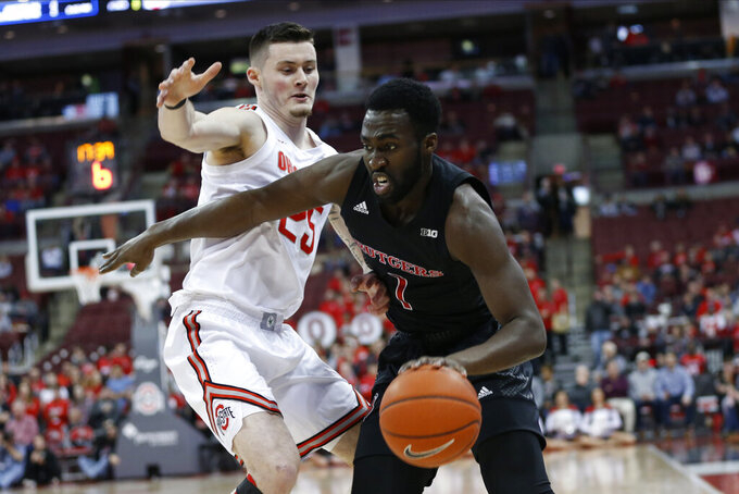 Rutgers' Akwasi Yeboah, right, drives to the basket against Ohio State's Kyle Young during the first half of an NCAA college basketball game Wednesday, Feb. 12, 2020, in Columbus, Ohio. (AP Photo/Jay LaPrete)