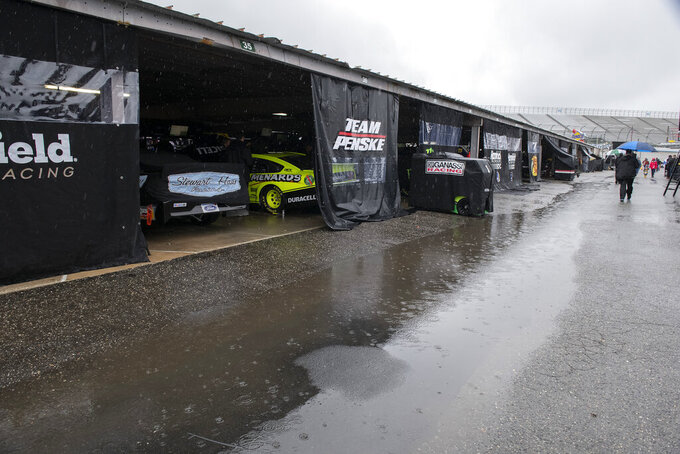 Rain falls in the garage area before a NASCAR Cup series auto race at Dover International Speedway in Dover, Del., Sunday, May 5, 2019. (AP Photo/Jason Minto)