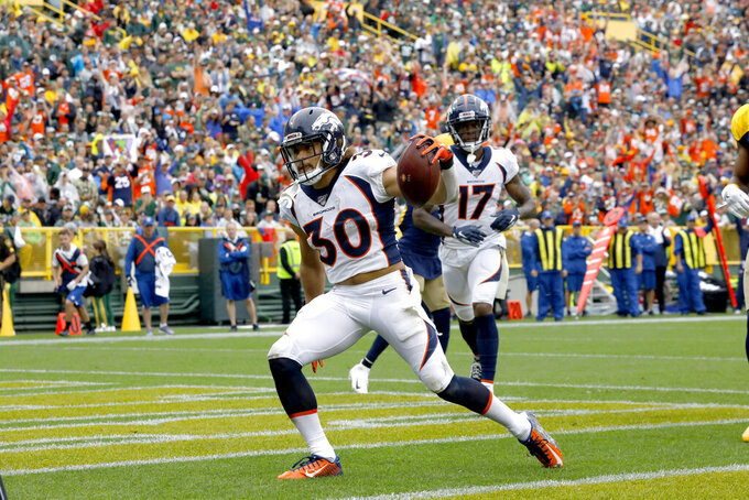 Denver Broncos running back Phillip Lindsay celebrates after scoring during the first half of an NFL football game against the Green Bay Packers Sunday, Sept. 22, 2019, in Green Bay, Wis. (AP Photo/Mike Roemer)