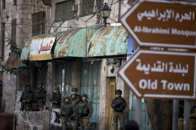 Israeli troops take their position during clashes with Palestinian demonstrators during a protest over Israeli settlement activity Monday, Dec. 9, 2019, in the West Bank city of Hebron.  (AP Photo/Majdi Mohammed)