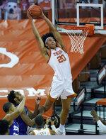 Texas forward Jericho Sims (20) scores against TCU during the first half of an NCAA college basketball game, Saturday, Feb. 13, 2021, in Austin, Texas. (AP Photo/Eric Gay)