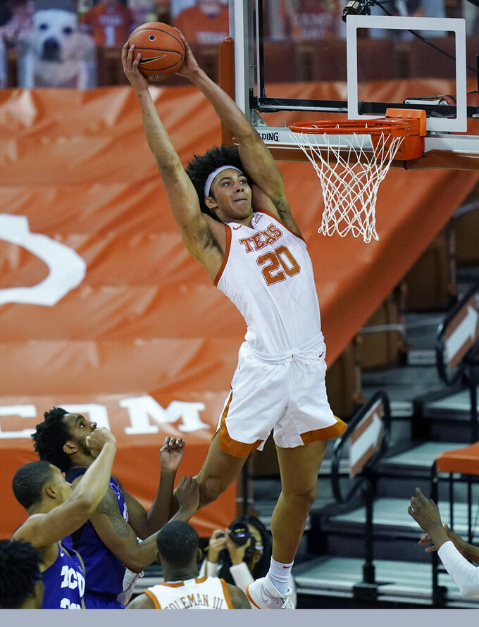 Texas forward Jericho Sims (20) scores against TCU during the first half of an NCAA college basketball game, Saturday, Feb. 13, 2021, in Austin, Texas. (AP Photo/Eric Gay)