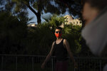Piotr Grabarczyk, from Poland, walks at a park in Barcelona, Spain, Thursday, July 30, 2020. Grabarczyk and his boyfriend are starting over in Spain, a country that — unlike Poland — allows same-sex couples the right to marry and adopt children. Like them, many LGBT people are choosing to leave Poland amid rising homophobia promoted by President Andrzej Duda and other right-wing populist politicians in power. (AP Photo/Felipe Dana)