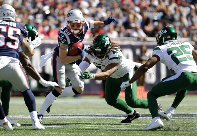 New England Patriots wide receiver Gunner Olszewski (80) tries to elude New York Jets linebacker Harvey Langi (44) in the first half of an NFL football game, Sunday, Sept. 22, 2019, in Foxborough, Mass. (AP Photo/Steven Senne)